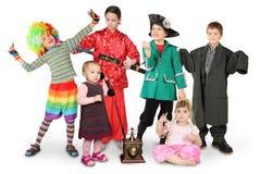 Kinderen in kostuums op wit Royalty-vrije Stock Foto
