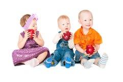 Kinderen met appelen Stock Foto