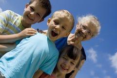 Kinderen met oma royalty-vrije stock afbeeldingen