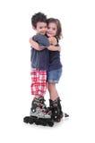 Kinderen met rol het schaatsen Stock Afbeelding