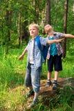 Kinderen met rugzakken Stock Afbeelding