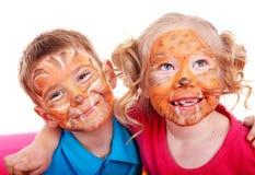 Kinderen met verf van gezicht. Stock Afbeelding