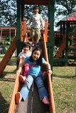 Kinderen op de dia Stock Afbeelding