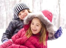 Kinderen op de sneeuw Stock Foto
