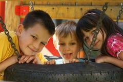 Kinderen op een speelplaats Stock Fotografie