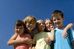 Kinderen op hemel Royalty-vrije Stock Afbeeldingen