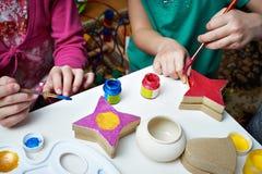 Kinderfarbe Weihnachtsspielwaren Stockbild