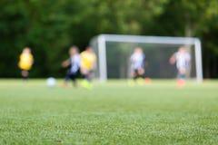 Kinderfußballunschärfe Stockfoto