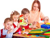 Kindergarden teacher with children. Royalty Free Stock Photo