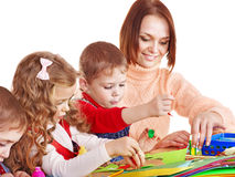Kindergarden teacher with children. royalty free stock images