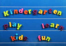 Kindergarten. Words on a board: play, learn, kids, fun royalty free stock photography