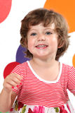 Kindergarten. Beautiful, laughing girl with bright coloured circles behind her stock photography