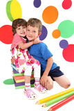 Kindergarten. Beautiful boy and girl hugging each other royalty free stock photography