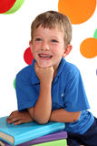 Kindergarten. Beautiful, laughing boy leaning on his hand with bright circles in the background stock image
