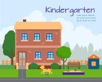 Kindergarten building with kids playground. Stock Photos