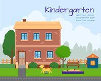 Kindergarten building with kids playground. Royalty Free Stock Photography