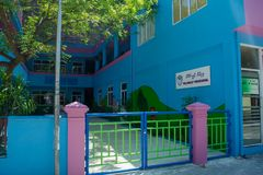 Kindergarten building painted blue and purple located at the tropical island Stock Photo