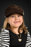 Kindergarten Child. Portrait of a kindergarten girl smiling and wearing stylish clothes, shot with a backlight Royalty Free Stock Photos