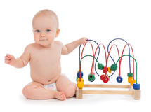 Kindergarten child baby toddler sitting and playing wooden educa Stock Images
