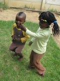 Kindergarten  children  dancing. Harare,Zimbabwe,December 12 2014.Two  kindergarten  children  dance  to  the  beat  of  music.More  children are  now going Royalty Free Stock Photos