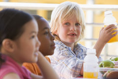 Kindergarten children eating lunch Royalty Free Stock Photo
