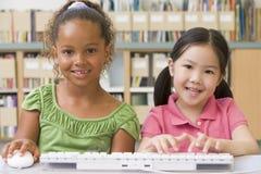 Kindergarten children using computer. Smiling royalty free stock image
