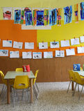 Kindergarten class with the chairs and many children's drawings Royalty Free Stock Image