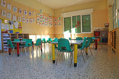 Kindergarten class with the green small chairs and small tables Royalty Free Stock Photos