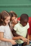 Kindergarten class reading a book Stock Photo