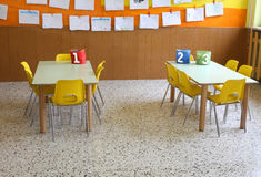 Kindergarten class with the yellow chairs and many children's dr Stock Photography