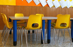 Kindergarten classroom with chairs and table Stock Photos