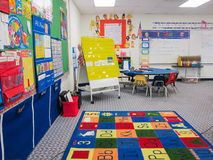 Kindergarten Classroom. Interior kindergarten classroom with calendar bulletin board,  table, chairs and alphabet rug