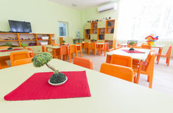 Kindergarten classroom with small chairs and tables Royalty Free Stock Photography