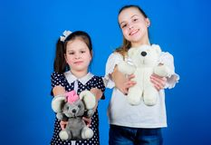 Kindergarten concept. small girls with soft bear toys. happy little sisters girls playing game in playroom. handmade royalty free stock images