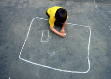 Kindergarten fun. Kid drawings on the asphalt ground shapes with white chalk in kidergarten Royalty Free Stock Photography