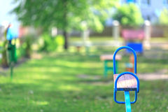 Kindergarten. The game platform in kindergarten, a swing, a rocking chair, a bench royalty free stock photo