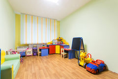 Kindergarten game room. Kindergarten nursery game room light green interior Royalty Free Stock Image