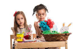 Kindergarten girls painting Easter decorations Royalty Free Stock Photos