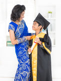 Kindergarten graduation day. Kindergarten graduation. Asian family, Indian mother and son on kinder graduate day royalty free stock image