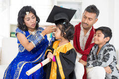 Kindergarten graduation with family. Kindergarten graduation. Asian Indian family, parents and children on kinder graduate day Royalty Free Stock Photography