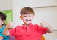 Kindergarten kid smile and thumbs up classoom at preschool inter. National,education concept Royalty Free Stock Photography