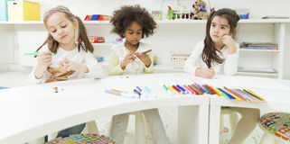Kindergarten. Little girls drawing and learning in the kindergarten royalty free stock image