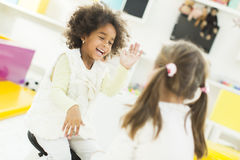 Kindergarten. Little girls playing and learning in the kindergarten royalty free stock photos