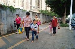 Kindergarten parents pick up the kids go home after school, Stock Image