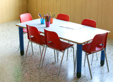Kindergarten school with pencils and small red chairs Stock Photos