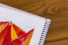 Kindergarten and school. Red and yellow paint. Children`s creativity. red triangle stock images