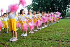 Kindergarten sport day. KUALA LUMPUR - 15 AUGUST 2010 : Unidentified children performing song with pom-pons at Taman Midah Kindergarten sport day on 15 August stock images