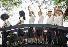 Kindergarten students with arms raised Stock Photography