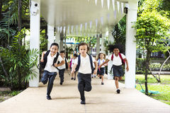 Kindergarten students running cheerful after school stock photo