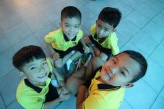 Kindergarten students smiling Royalty Free Stock Image